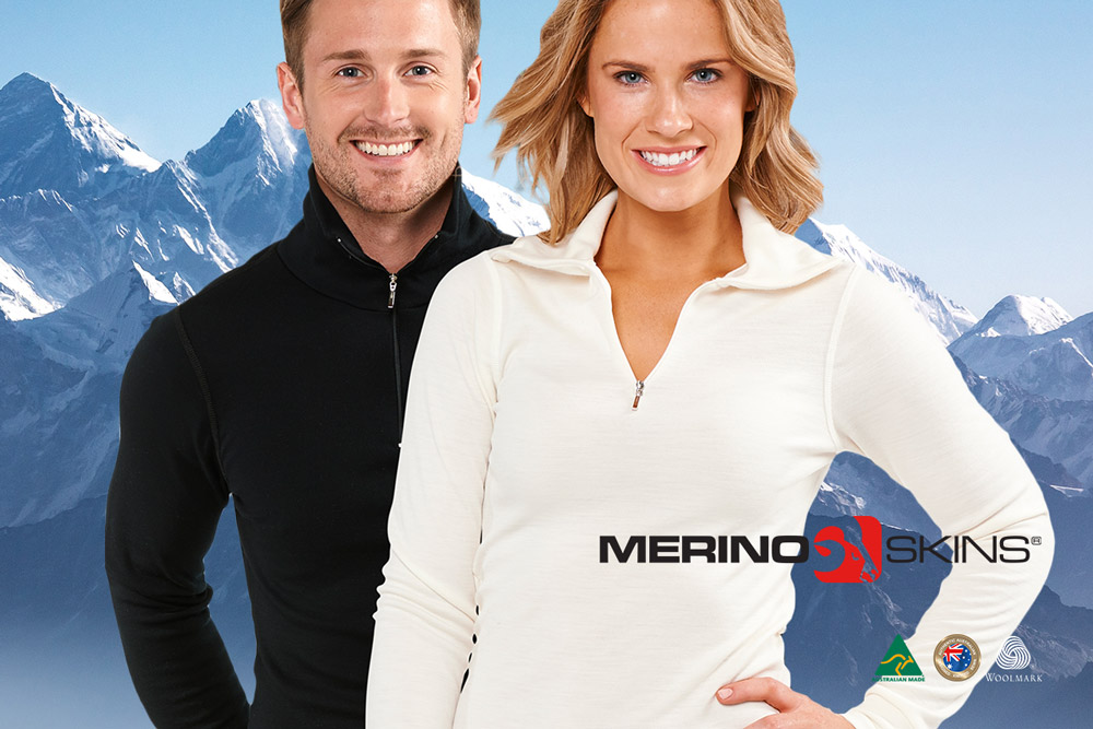 man and lady in merino skins long sleeve zip jumper