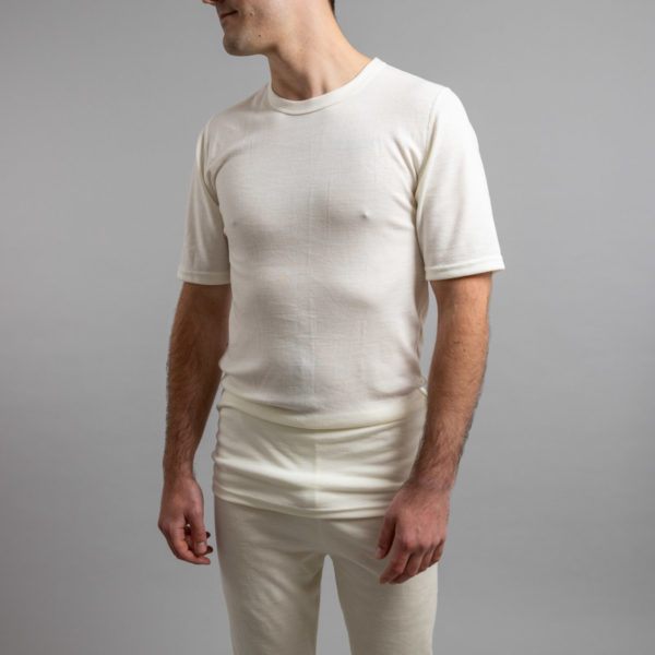 Male wearing White SP121 Merino Skins – Unisex Short Sleeve Crew Neck