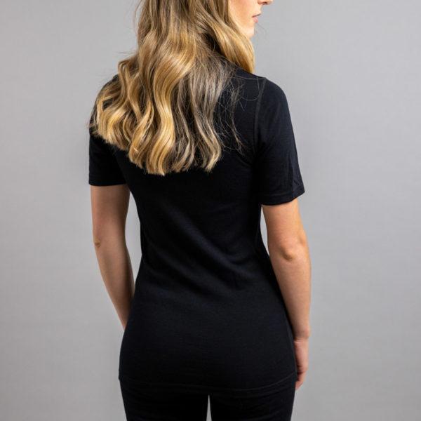 Lady wearing SP121B Merino Skins – Unisex Short Sleeve Crew Neck – Black
