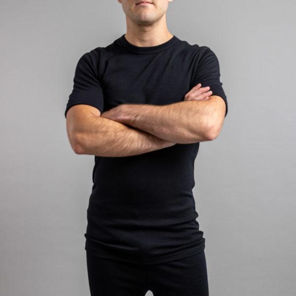 Male wearing SP121B Merino Skins – Unisex Short Sleeve Crew Neck – Black