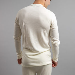 Male wearing White SP191 Merino Skins – Unisex Long Sleeve Crew Neck