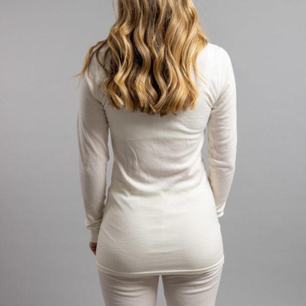 Female wearing White SP191 Merino Skins – Unisex Long Sleeve Crew Neck
