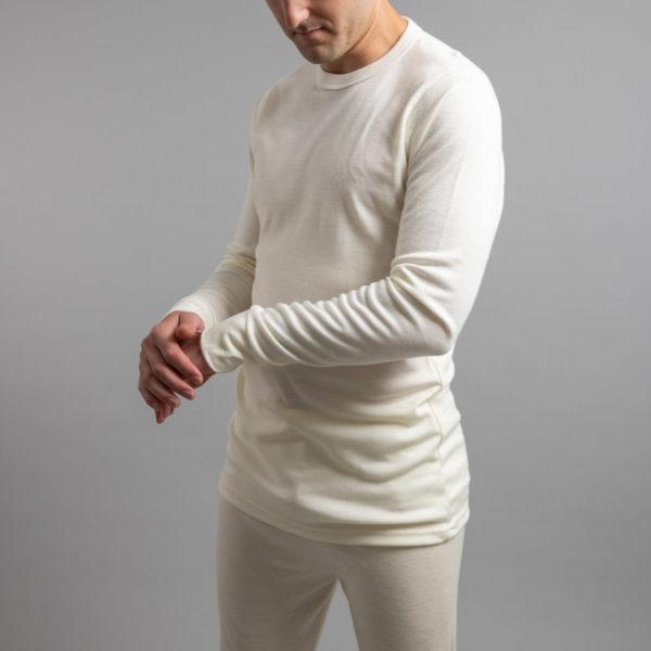 Male wearing White SP191 Merino Skins – Unisex Long Sleeve Crew Neck