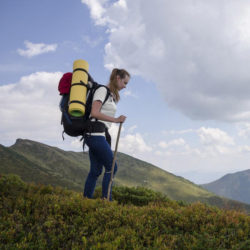 a lady hiking in Merino Skins t shirt